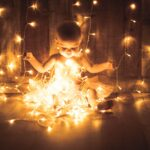 baby playing with lights