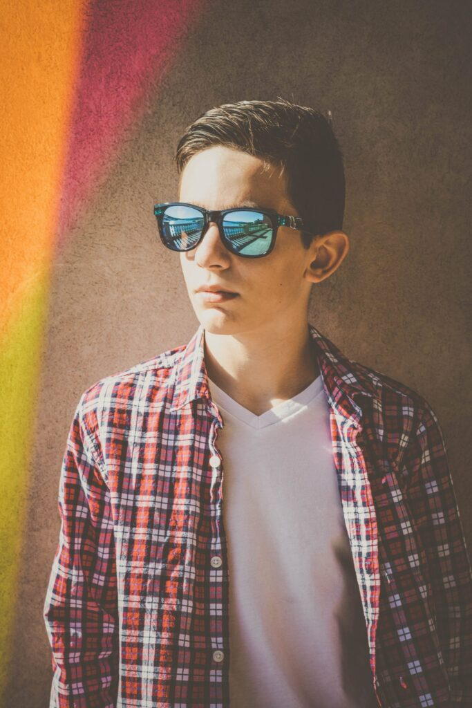 cool young man with glasses closeup